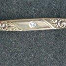 Avon bar pin rhinestone center gold tone scrolls circa 1980 s jewelry