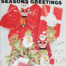 Plastic Canvas Seasons Greetings oranments and package designs