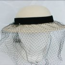Light tan Importina hat black net has rhinestones velvet band some stains inside