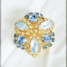 Blue and opalescent pronged rhinestone pin vintage brooch jewelry