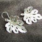 BSK clip on silver tone leaf earrings