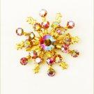 "Vintage rhinestone pin red iridescent stones gold tone 1 1/2"" diameter"