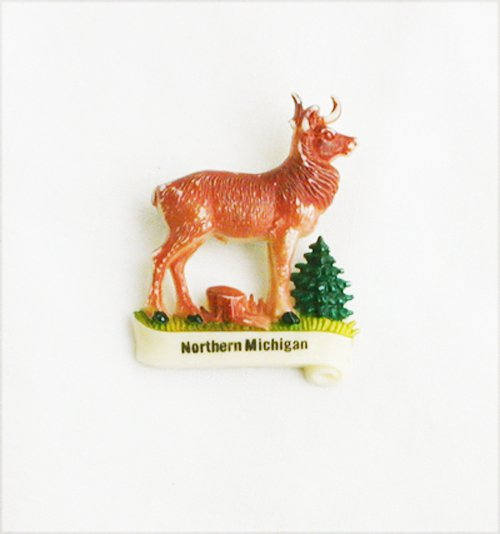 Vintage celluloid pin Germany deer marked Northern Michigan