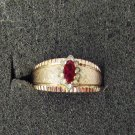 Ring 14KT GE ESPO gold band red stone surrounded by rhinestones size 6 1/2