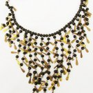 Black glass bead & brass metallic dangles necklace 23 inches hook closure