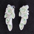 Vintage white plastic green rhinestones long clip dangle earrings