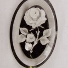 Acrylic pin clear with black background white rose flowers oval 1 7/8 x 1 3/8""