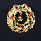 LJM Laurentian Jewelry Montreal gold tone wreath & bell pin rhinestones