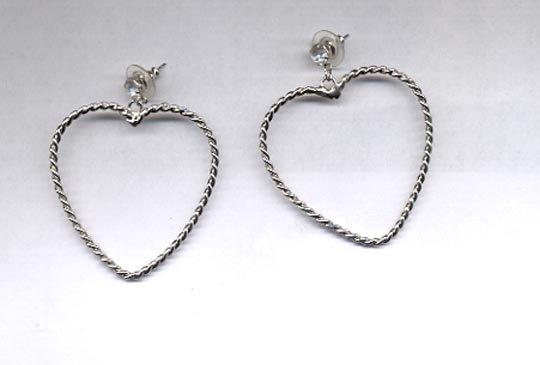 Avon  heartful hoop pierced earrings- large- silvertone