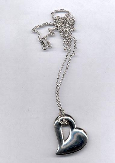 Avon Sculptured heart Pendant- silvertone