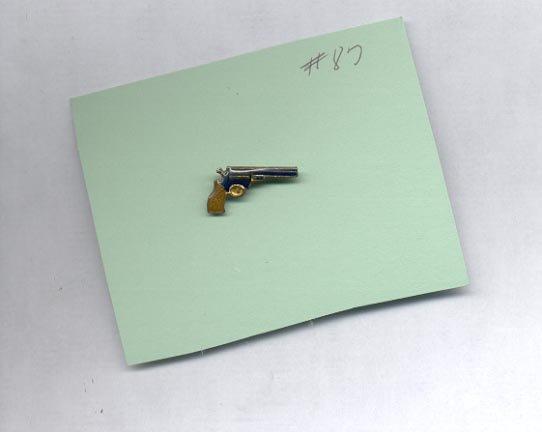 Single Gun  hat (lapel ) pin (#87)