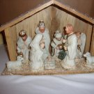 Nativity scene  - wood manger and 9 figures inside