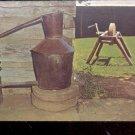 Moon Shiner still and grinder    Postcard- (#  603)