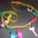 Vintage Plastic Belt with 12 plastic novelty charms retro- 1990s.