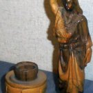 Hand carved water woman by well wood