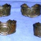 Six heavy metallic napkin rings