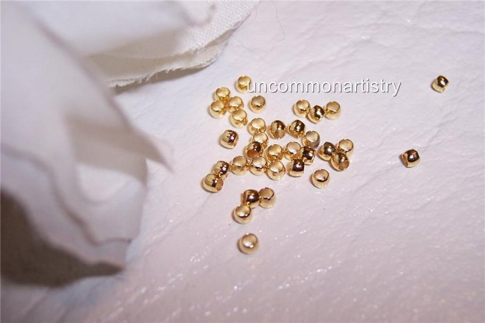 CRIMP BEADS 2 mm GOLD PLATED q.100