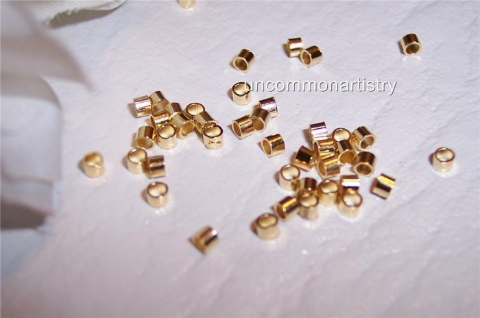 CRIMP BEADS 1.5mm GOLD PLATED q.100
