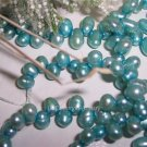 "Fresh Water RICE PEARLS 6x4mm TEAL top-drilled 16"" Str."