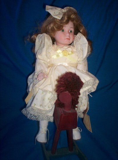 """LYNETTE 14"""" MUSICAL DYNASTY DOLL WITH WOODEN HORSE"""