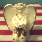 """""""Knelling Angel holding a Dove"""""""