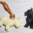 Vintage Celluloid Scottie Charms, one white one black.