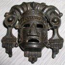 Vintage primitive cast mask brooch