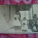 Vintage Photographic Postcard- 3 girls with dolls