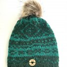 Hand knit Nordic design hat with super soft fleece lining and removable Pompom