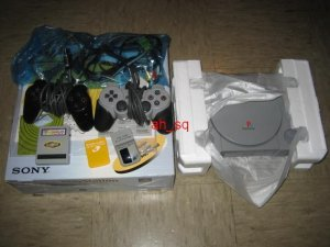 Sony Universal PlayStation - Game console w/ Pelican gray gun with free games!