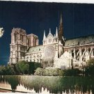 Notre Dame at night Paris France vintage postcard
