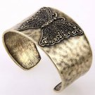 Antique Gold Tone Metal Cuff Bracelet with Butterfly Engraving