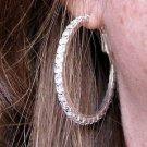 """1.5"""" Silvertone White Crystal Hoop Earrings"""