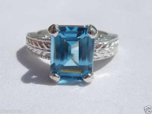 4.15 Carat Medium Blue Topaz Ring Sterling Silver .925 Emeral Cut Engraved Shank