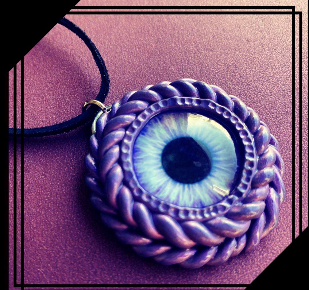 Purple Cyclops necklace  [0007]