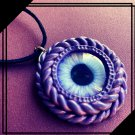 Purple Cyclops necklace  [0007]