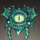 Green Tri-cloptic Dragon pendant  [0006]