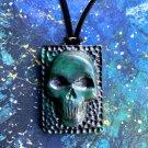 Skull frozen in carbonite necklace [0020]