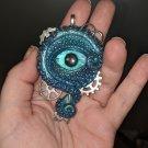 Steampunk Blue Cyclops Eye Pendant [0047]