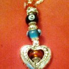 Awesome detail on this special 16 inch silvertone necklace with colored beads
