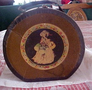 Dolly Round Suitcase & Items