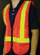 Safety Vest.  One size fits all.  Orange with reflective stripes.... S &H is $3.95 or  $2.00