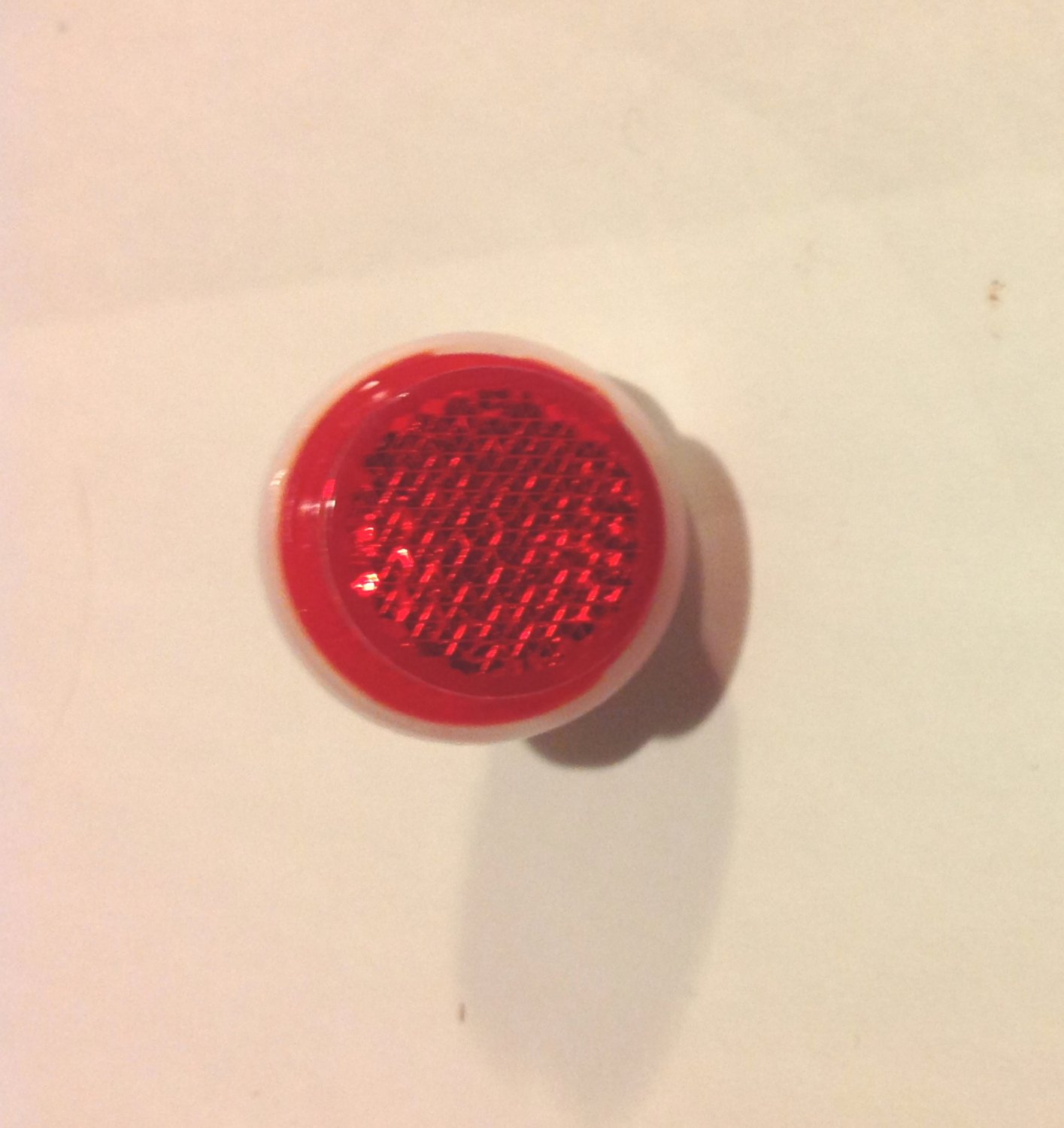 """Red Rear Reflector for bicycle, 1"""" diameter. with bolt & nut... S&H is $1.95 or $0.45"""