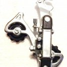 Rear DERAILLEUR for bicycle. 6, 7 speed ( 18, 21 speed ). Mounts on axle.  S&H $5.00 or $3.00