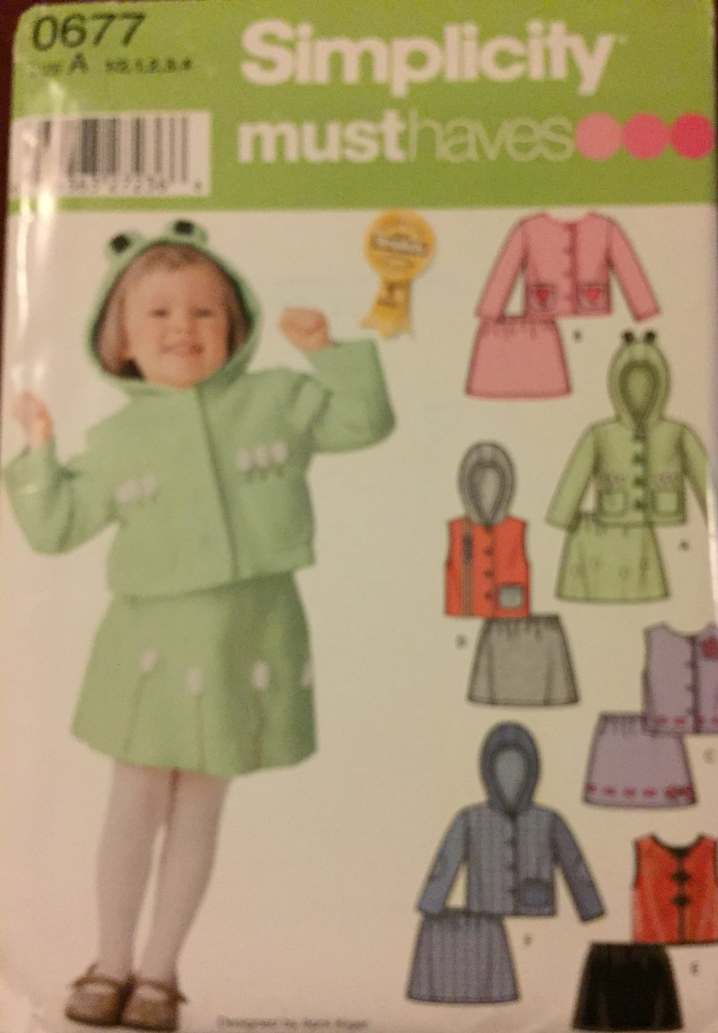 Simpliicity 0677 Must Have Sewing pattern Toddlers' Jacket or vest and skirt sizes 1/2, 1, 2, 3. 4