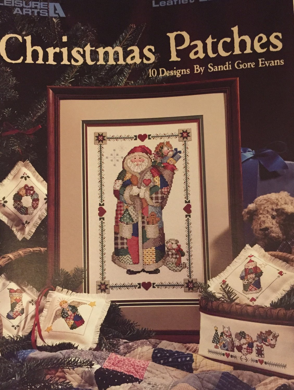 SOLD OUT Leisure Arts #2202 Christmas Patches Cross Stitch Pattern 10 Designs by Sandi Gore Evans.
