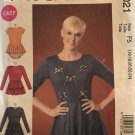 Misses' Tops  McCall's M7021, Size 16-18-20-22-24 Sewing Pattern knit, pullover top with peplum