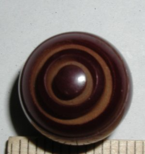 Cranberry Carved Bakelite Ball Button