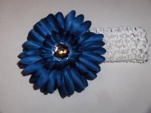 Deep Blue Gerbera Daisy hair clip on a white 1.5 inch crochet headband