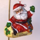 Vintage Christmas Ornament Santa on a sled Early Plastic or Celluloid